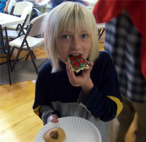 Girly Eating Decorated Christmas Cookies